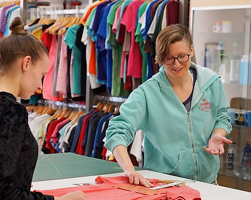 An Imprint Revolution employee helps one of their customers.