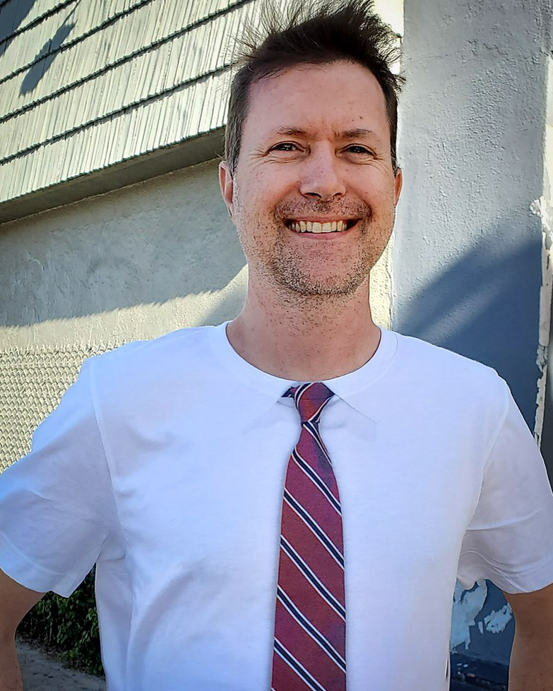 """David Anderson, owner of Imprint Revolution, sporting one of their """"tie t-shirts""""."""