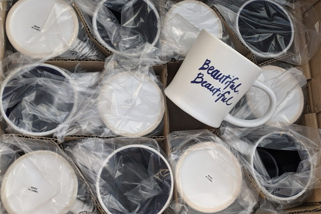 Custom dye sublimation mugs are packaged and ready for shipping.