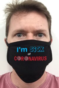 """Photo of the owner sporting a protective face mask that says """"I'm sick of coronavirus""""."""